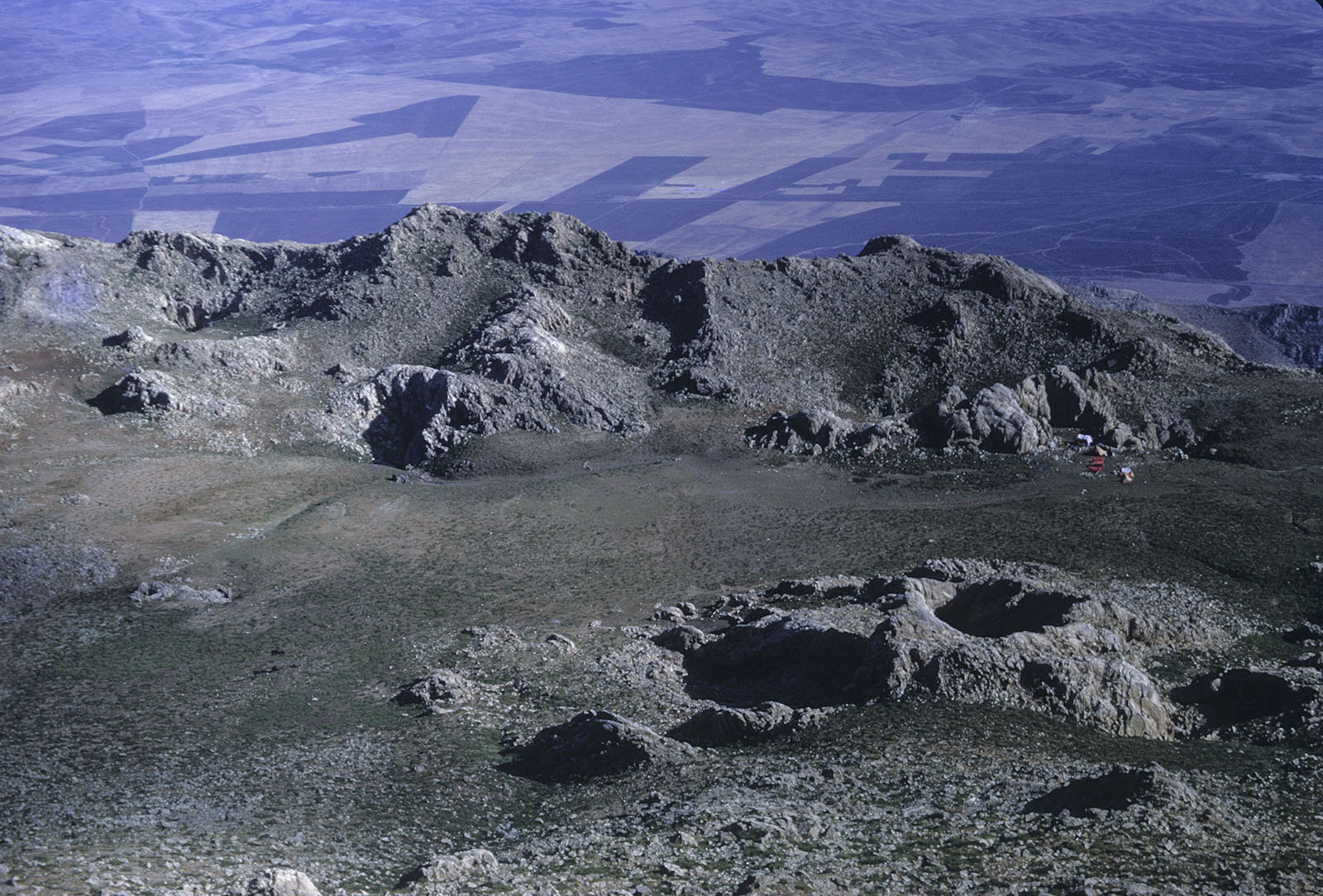 The Parau basin, seen from top of mountain, camp on far right (Tony Waltham)